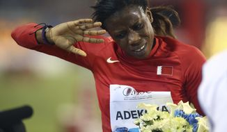 FILE - In this Friday, May 9, 2014 file photo, Kemi Adekoya of Bahrain gestures after winning the 400m hurdles at the IAAF Diamond League in the Qatari capital Doha. Former world indoor 400-meter champion Kemi Adekoya has been banned for doping in the latest drug case to hit Bahrain's stable of elite African-born runners, it was announced Friday, July 19, 2019. The Athletics Integrity Unit, which oversees doping cases in track and field, says Adekoya tested positive for the banned steroid stanozolol. (AP Photo/Osama Faisal, File)