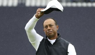 Tiger Woods of the United States waves his hat to the crowd as he completes his second round of the British Open Golf Championships at Royal Portrush in Northern Ireland, Friday, July 19, 2019. Woods finished at 6 over par for the two rounds. (AP Photo/Peter Morrison)