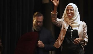 U.S. Rep. Ilhan Omar, D-Minn., holds a Medicare for All town hall with Rep. Pramila Jayapal, D-Wash., (not pictured) and other state lawmakers, Thursday, July 18, 2019, in Minneapolis. (Richard Tsong-Taatarii/Star Tribune via AP)