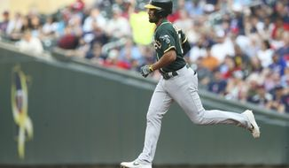 Oakland Athletics' Marcus Semien rounds the bases on a solo home run off Minnesota Twins pitcher Jake Odorizzi in the first inning of a baseball game Friday, July 19, 2019, in Minneapolis. (AP Photo/Jim Mone)