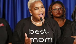 "In this May 7, 2019, file photo Rep. Erica Thomas, D-Austell, speaks during a news conference in Atlanta. Thomas says she was verbally attacked in a supermarket by a white man who told her, ""Go back where you came from."" Rep. Erica Thomas of Austell tearfully described the confrontation in a Facebook video Friday, July 19, 2019. She acknowledged being in an express line with too many items but said she got in the line because she is nine months pregnant and cannot stand for long periods. (Bob Andres/Atlanta Journal-Constitution via AP)"