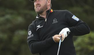 Northern Ireland's Graeme McDowell reacts after hitting his shot on the 5th tee during the first round of the British Open Golf Championships at Royal Portrush in Northern Ireland, Thursday, July 18, 2019.(AP Photo/Jon Super)