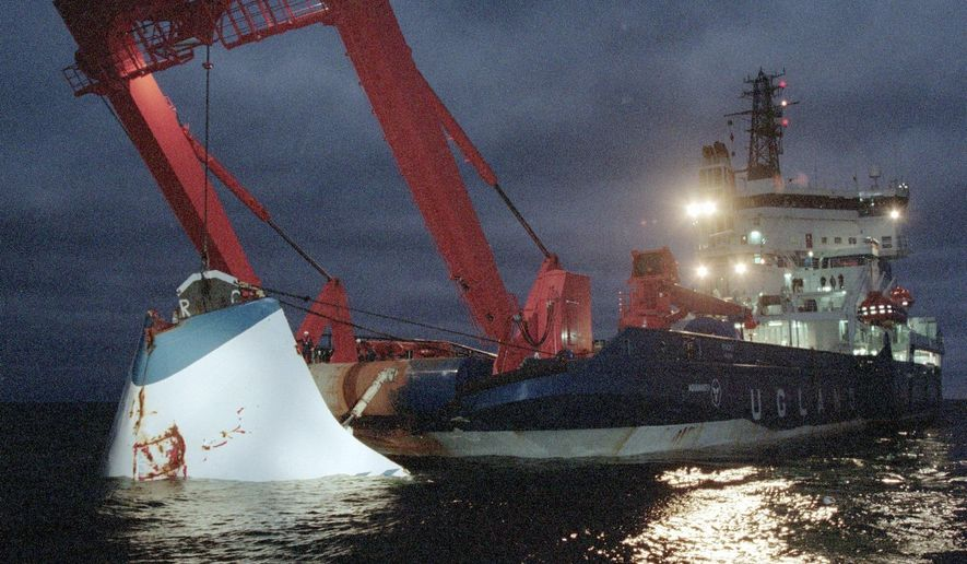 FILE - In this Nov. 19, 1994 file photo, the bow door of the sunken passenger ferry M/S Estonia is lifted up from the bottom of the sea, off Uto Island, in the Baltic Sea, near Finland. A Paris court is set to adjudicate on a compensation claim related to the 1994 sinking of an Estonian ferry, which remains one Europe's deadliest maritime disasters. The court is set to rule Friday, July 19, 2019 on the claim from more than 1,000 survivors and relatives of victims. (Jaakko Aiikainen/Lehtikuva via AP, file)