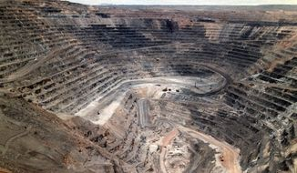 FILE - This undated file photo shows Barrick Goldstrike Mines' Betze-Post open pit near Carlin, Nev. A three-judge panel with the U.S. Court of Appeals for the District of Columbia ruled Friday, July 19, 2019, that state and federal programs ensure mining companies take financial responsibility for their pollution. (Adella Harding/The Daily Free Press via AP, File)