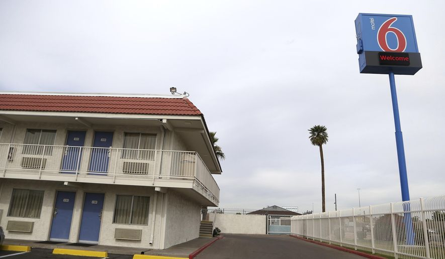 FILE - This Jan. 29, 2019, file photo, shows a Motel 6 in Phoenix. A revised settlement for Motel 6 guests who say the national chain invaded their privacy by giving their information to immigration authorities is returning to court for a judge's review. A federal judge is to decide Friday, July 19, 2019, on the proposal increasing to $10 million the total amount available for claims. (AP Photo/Ross D. Franklin, File)