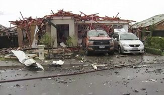 This imaged made from a video, shows a damaged home following a gas explosion in Christchurch, New Zealand Friday, July 19, 2019. Several people were injured and dozens of homes evacuated in the New Zealand city of Christchurch on Friday after a huge gas explosion destroyed one home and damaged others. (TVNZ via AP)
