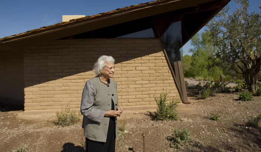 In this March 1, 2010 file photo,  retired Supreme Court Justice Sandra Day O'Connor stands in front of her 1958 adobe home that was moved and restored at the Arizona Historical Society Museum in Tempe, Ariz. O'Connor's 1950s adobe home in metro Phoenix is being listed on the National Register of Historic Places. The State Historic Preservation Office's announcement Friday, July 19, 2019,  says the National Park Service approved Arizona's nomination of the Sandra Day O'Connor House for placement on the register, which the office described as the nation's list of properties considered worthy of preservation. (David Wallace/The Arizona Republic via AP) **FILE**