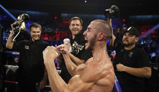 In this Saturday, Oct. 20, 2018 file photo, Maxim Dadashev celebrates after defeating Antonio DeMarco during a junior welterweight bout in Las Vegas. On Saturday, July 20, 2019, doctors said Dadashev had surgery at a Maryland hospital for swelling on his brain after collapsing outside the ring after losing a match. (AP Photo/John Locher) **FILE**
