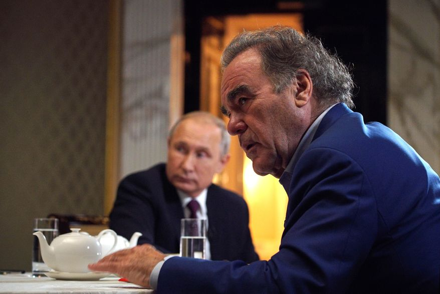 "This photo taken on Wednesday, June 19, 2019, and distributed by Kremlin Press Service shows Russian President Vladimir Putin during an interview with American movie director Oliver Stone for his ""Revealing Ukraine"" documentary in the Kremlin in Moscow, Russia. (Alexei Druzhinin, Sputnik, Kremlin Pool Photo via AP)"