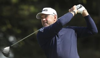England's Lee Westwood tees off from the 5th hole during the third round of the British Open Golf Championships at Royal Portrush in Northern Ireland, Saturday, July 20, 2019.(AP Photo/Jon Super)