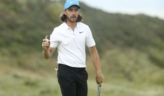 England's Tommy Fleetwood reacts after he saves parr on the 15th green during the third round of the British Open Golf Championships at Royal Portrush in Northern Ireland, Saturday, July 20, 2019.(AP Photo/Jon Super)