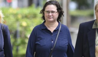 FILE - In this June 28, 2019 file photo former Honolulu deputy prosecutor Katherine Kealoha walks into federal court in Honolulu for a hearing to decide if she should be held while awaiting sentencing on conspiracy charges.  A newly appointed, taxpayer-funded attorney representing  Kealoha wants to delay her trial on bank fraud and identity theft charges.  Gary Singh was appointed to represent Kealoha after her former taxpayer-funded attorney Cynthia Kagiwada asked to withdraw from the case, citing a breakdown in the attorney-client relationship. At a hearing Thursday, July 18, Singh said he needs more time and sought a delay until January.  (AP Photo/Caleb Jones, File)
