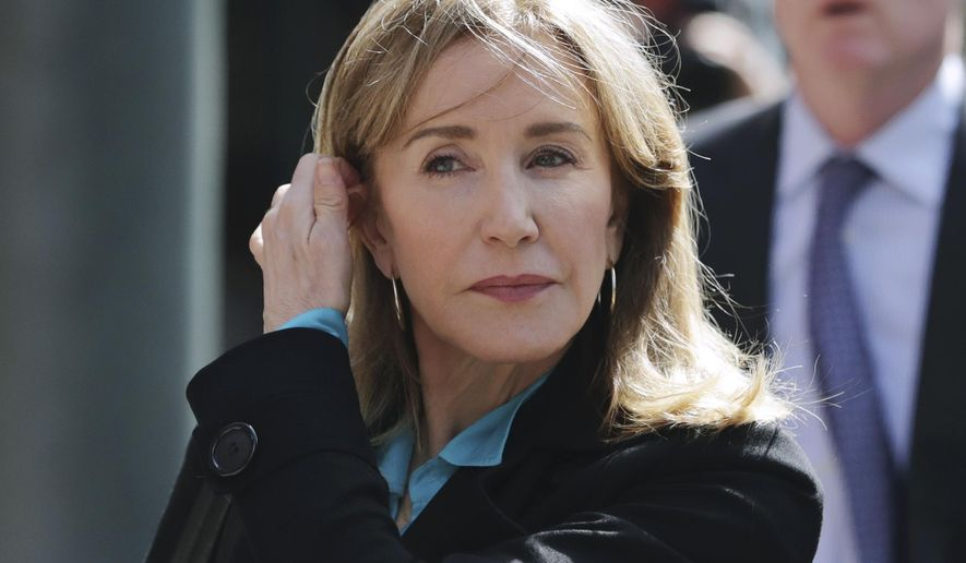 In this April 3, 2019, file photo, actress Felicity Huffman arrives at federal court in Boston to face charges in a nationwide college admissions bribery scandal. Huffman's co-stars in a new Netflix movie say they found her remorseful about her role in a college admissions scandal. (AP Photo/Charles Krupa, File)
