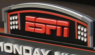 This Sept. 16, 2013, file photo shows the ESPN logo prior to an NFL football game between the Cincinnati Bengals and the Pittsburgh Steelers, in Cincinnati. ESPN is reminding employees of the network's policy to avoid talking about politics after radio talk show host Dan Le Batard criticized President Donald Trump and his recent racist comments and ESPN itself on the air this week. (AP Photo/David Kohl, File)