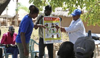 In this Tuesday, Feb. 26, 2019, file photo, health workers give a training presentation about how to detect and prevent the spread of Ebola, in an army barracks outside South Sudan's town of Yei. (AP Photo/ Sam Medrick)