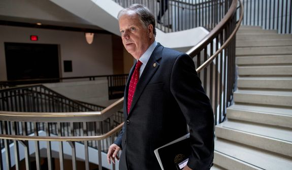 Sen. Doug Jones, Alabama Democrat, won the special Senate election in 2017. Critics say he's painted himself into a corner because Mr. Jones said he'll support whoever the Democratic presidential pick is. (Associated Press)