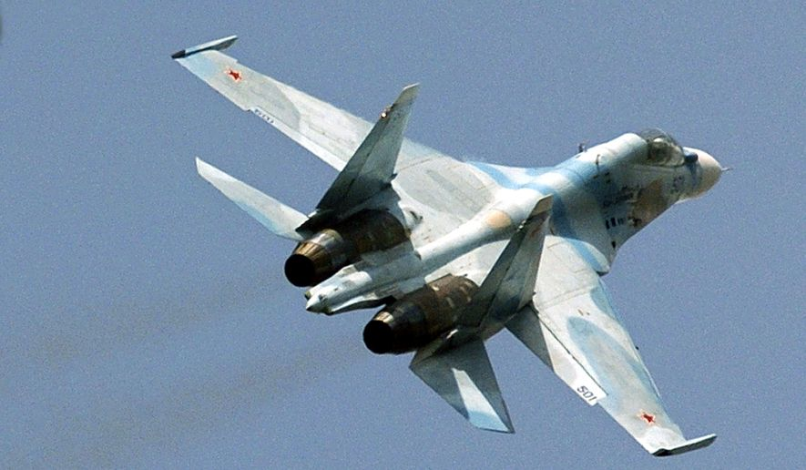A Russian Sukhoi Su-30 fighter jet flies during Venezuela's independence day military parade in Fort Tiuna in Caracas, Venezuela, in this Wednesday, July 5, 2006, file photo. Russia's state-controlled arms trader, Rosoboronexport, and top aircraft maker, Sukhoi, criticized Washington Saturday for imposing sanctions against them over dealings with Iran, while the defense ministry said the move reflected U.S. annoyance at arms sales with Venezuela. Last month, Venezuelan President Hugo Chavez visited Russia and sealed a deal to buy 24 Sukhoi Su-30 fighter jets.  (AP Photo/Gregorio Marrero, File)