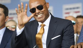 National Baseball Hall of Fame inductee Mariano Rivera, waves to fans while waiting to speak during the National Baseball Hall of Fame induction ceremony at the Clark Sports Center on Sunday, July 21, 2019, in Cooperstown, N.Y. (AP Photo/Hans Pennink)