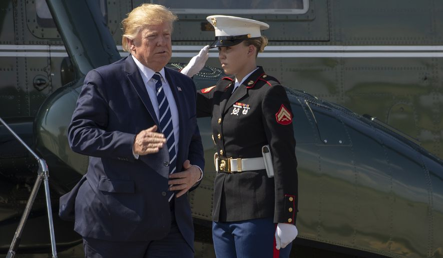 President Donald Trump a Marine Corps honor guard as he walks from Marine One to board Air Force One at Morristown Municipal Airport, in Morristown, N.J., Sunday, July 21, 2019. (AP Photo/Manuel Balce Ceneta)
