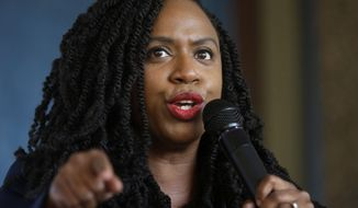 U.S. Rep. Ayanna Pressley, D-Mass., addresses a crowd during ceremonies before the start of the Roxbury Unity Parade, Sunday, July 21, 2019, in Boston's Roxbury neighborhood. (AP Photo/Steven Senne) ** FILE **