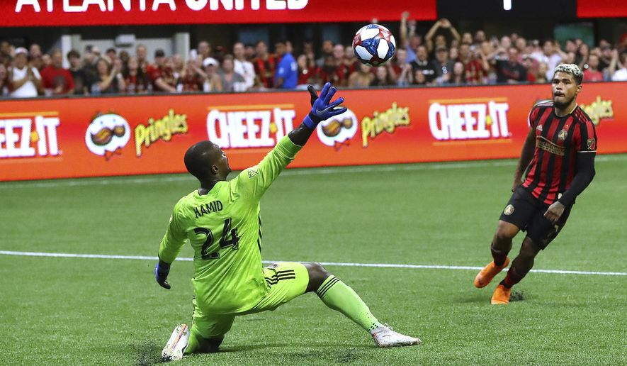 Atlanta United forward Josef Martinez scores a goal past D.C. United goalkeeper Bill Hamid for a 2-0 victory in a soccer match on Sunday, July 21, 2019, in Atlanta. (Curtis Compton/Atlanta Journal-Constitution via AP) ** FILE **