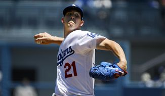 Los Angeles Dodgers starting pitcher Walker Buehler throws to the plate during the first inning of a baseball game against the Miami Marlins Sunday, July 21, 2019, in Los Angeles. (AP Photo/Mark J. Terrill)