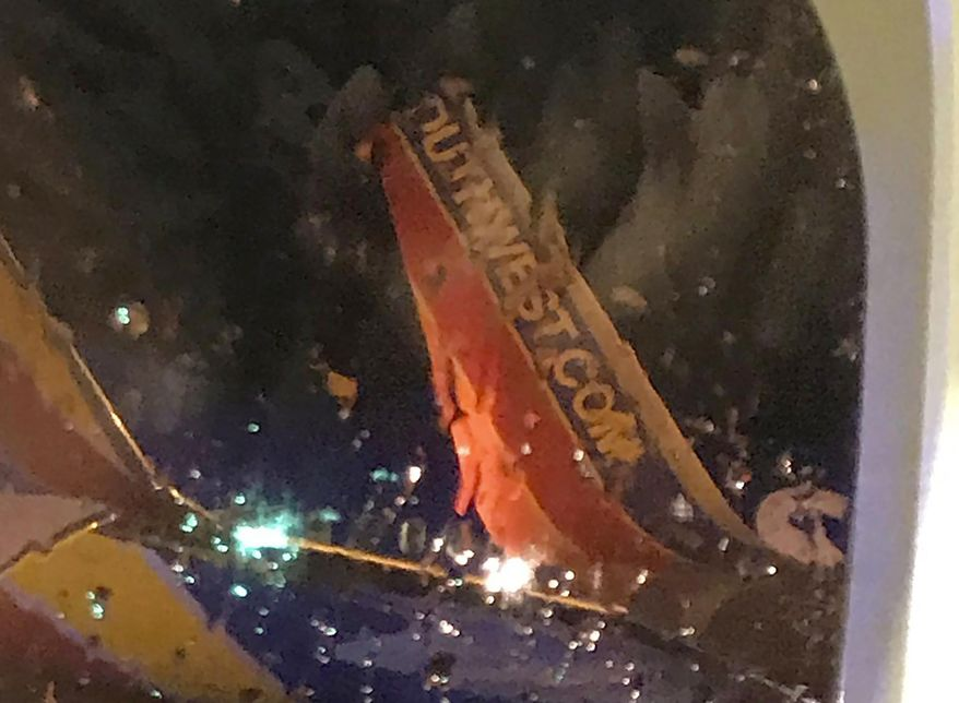 "This photo taken onboard by a passenger on a Southwest Airlines flight to Atlanta appears to show the top fin of another Southwest Airlines plane clipped off after the two planes collided, Saturday, July 20, 2019, on the tarmac of Nashville International Airport, in Nashville, Tenn. The airline says both planes returned to the gate ""under their own power"" and were taken out of service for evaluation. The Southwest flights will continue to the scheduled destinations using news planes. (Eric Borden via AP)"
