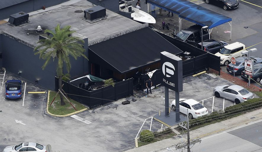 FILE - In this June 12, 2016 file photo, law enforcement officials work at the Pulse gay nightclub in Orlando, Fla., following the a mass shooting. A federal judge in California declined Wednesday, Feb. 1, 2017, to release Noor Salman, the widow of Omar Mateen, who killed dozens of people at the nightclub, after prosecutors said she accompanied her husband on scouting trips for potential targets that included a Disney shopping complex. (AP Photo/Chris O'Meara, File)