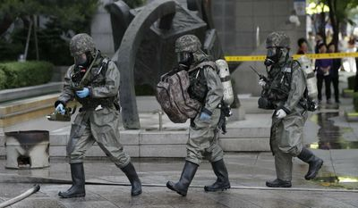 South Korean military soldiers wearing anti-chemical gears participate in a drill as a part of the Ulchi Taeguk exercises in Seoul, South Korea, Wednesday, May 29, 2019. The four-day Ulchi Taeguk exercises will include massive civilian evacuation drills and a South Korea-only military drill aimed at preparing for war situations and disasters. (AP Photo/Lee Jin-man)