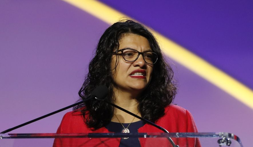 Rep. Rashida Tlaib, D-Mich., addresses the 110th NAACP National Convention, Monday, July 22, 2019, in Detroit. (AP Photo/Carlos Osorio) ** FILE **