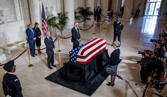 President Donald Trump and first lady Melania Trump pay their respects as the late Supreme Court Justice John Paul Stevens lies in repose in the Great Hall of the Supreme Court in Washington, Monday, July 22, 2019. (AP Photo/Andrew Harnik, pool)
