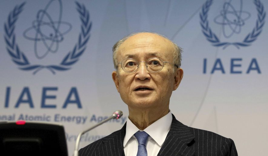 In this Nov. 22, 2018, file photo, International Atomic Energy Agency (IAEA) Director General Yukiya Amano of Japan addresses the media during a news conference after a meeting of the IAEA board of governors at the International Center in Vienna, Austria. The IAEA said Tuesday, July 22, 2019, it is announcing with regret the death of Amano. The Secretariat did not say how Amano, who was 72, died. (AP Photo/Ronald Zak)