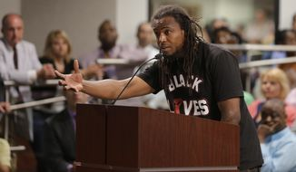 FILE - In this April 9, 2015 file photo, Muhiyidin d'Baha, also known as Muhiyidin Moye, speaks during a meeting with North Charleston city council in North Charleston, S.C. A New Orleans man, Roosevelt Iglus, has pleaded guilty to manslaughter in the slaying of Black Lives Matter activist Muhiyidin d'Baha. Authorities said Iglus tried to knock d'Baha off his bicycle and shot at him as he rode away Feb. 6, 2018 in New Orleans. The plea agreement  goes to a judge Tuesday, July 23, 2019. (AP Photo/Chuck Burton, File)