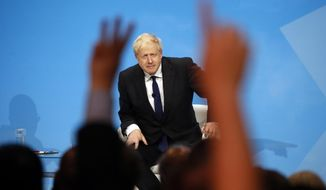 Conservative party leadership candidate Boris Johnson answers questions during a Conservative leadership hustings at ExCel Centre in London, Wednesday, July 17, 2019. The two contenders, Jeremy Hunt and Boris Johnson are competing for votes from party members, with the winner replacing Prime Minister Theresa May as party leader and Prime Minister of Britain's ruling Conservative Party. (AP Photo/Frank Augstein)