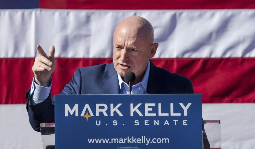 In this February 2019 file photo, former astronaut Mark Kelly speaks during his senate campaign kickoff event in Tucson, Ariz. (Mike Christy/Arizona Daily Star via AP, File)