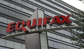 This July 21, 2012, file photo shows signage at the corporate headquarters of Equifax Inc., in Atlanta. Equifax will pay up to $700 million to settle with the Federal Trade Commission and others over a 2017 data breach that exposed Social Security numbers and other private information of nearly 150 million people. (AP Photo/Mike Stewart, File)