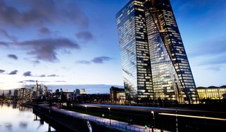 In this Tuesday, Dec. 11, 2018 photo the European Central Bank (ECB) sits next to the river Main in Frankfurt, Germany. The European Central Bank could take action including a possible rate cut at its policy meeting on Thursday, as central banks around the globe get ready to rev up stimulus in order to support the long-running recovery from the Great Recession. (AP Photo/Michael Probst)