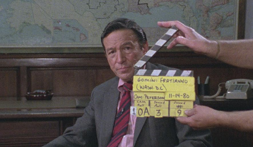 """This image released by Magnolia Pictures shows Mike Wallace in a scene from the documentary """"Mike Wallace Is Here."""" (Magnolia Pictures via AP)"""