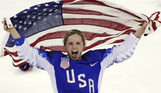 FILE - In this Feb. 22, 2018, file photo, Jocelyne Lamoureux-Davidson, of the United States, celebrates after winning against Canada in the women's gold medal hockey game at the 2018 Winter Olympics in Gangneung, South Korea. Olympic women's hockey gold medalists Lamoureux-Davidson and her sister Monique Lamoureux-Morando have unveiled their foundation that has a goal of benefiting underserved children and communities, primarily in their home state of North Dakota. The 30-year-old Grand Forks natives and University of North Dakota standouts helped the United States win the gold medal in South Korea in 2018. (AP Photo/Matt Slocum, File)