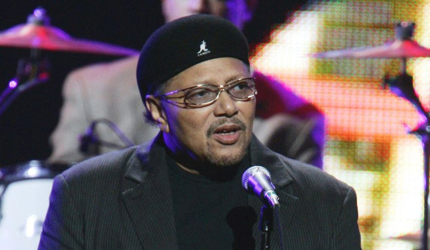 """This Sept. 20, 2005, file photo shows singer Art Neville performing during the """"From the Big Apple to the Big Easy"""" benefit concert in New York. Neville, a member of one of New Orleans' storied musical families, the Neville Brothers, and a founding member of the groundbreaking funk band The Meters, has died at age 81. Neville's manager, Kent Sorrell, confirmed that Neville died Monday, July 22, 2019. The cause of death was not immediately available. (AP Photo/Jeff Christensen, File)"""