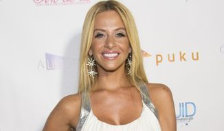 """FILE - In this July 21, 2014, file photo, Dina Manzo attends """"The Real Housewives of New Jersey"""" White Party at the Woodbury Country Club on Monday, in New York. James Mainello, allegedly involved in the home invasion of the former """"Real Housewives of New Jersey"""" cast member, has been indicted on Monday, July 22, 2019, on several counts, including robbery and aggravated assault. (Photo by Scott Roth/Invision/AP, File)"""