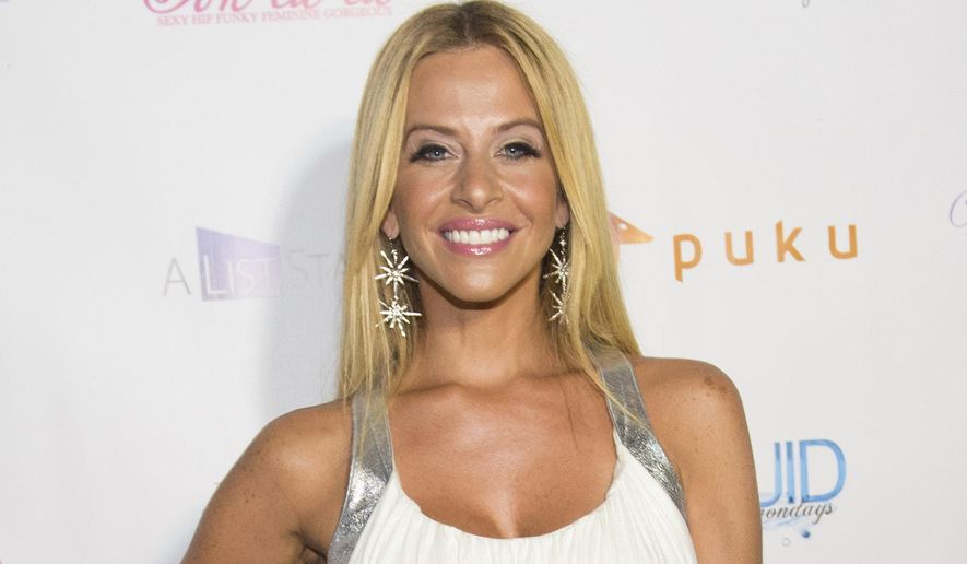 "FILE - In this July 21, 2014, file photo, Dina Manzo attends ""The Real Housewives of New Jersey"" White Party at the Woodbury Country Club on Monday, in New York. James Mainello, allegedly involved in the home invasion of the former ""Real Housewives of New Jersey"" cast member, has been indicted on Monday, July 22, 2019, on several counts, including robbery and aggravated assault. (Photo by Scott Roth/Invision/AP, File)"