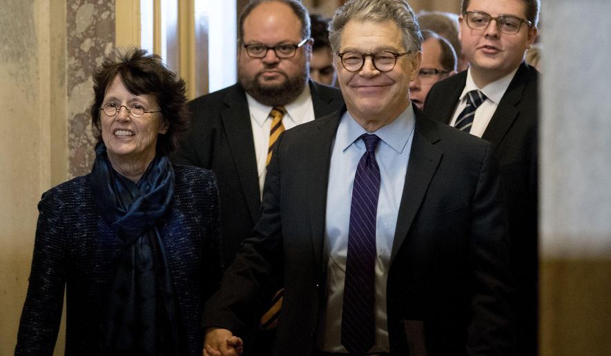 """FILE - In this Dec. 7, 2017, file photo, Sen. Al Franken, D-Minn., second from right, holds hands with his wife Franni Bryson, left, as he leaves the Capitol after speaking on the Senate floor on Capitol Hill in Washington. Franken says he """"absolutely"""" regrets resigning from the Senate after eight women accused him of unwanted kissing or touching. Franken made the comments in an article published by the New Yorker magazine on Monday, July 22, 2019. (AP Photo/Andrew Harnik, File)"""