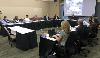 The University of Alaska Board of Regents meets in an emergency meeting in Anchorage, Alaska Monday, July 22, 2019. Regents voted 10-1 to declare a financial exigency, allowing administrators to expedite layoffs of tenured faculty in the face of severe budget issues. (AP Photo/Dan Joling)