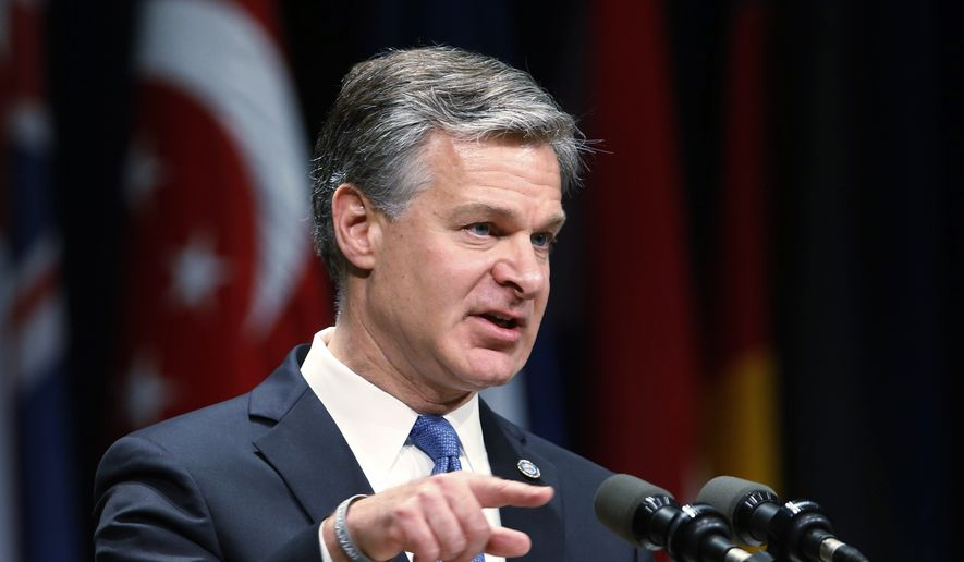 In this  June 7, 2019, file photo, Director of the Federal Bureau of Investigation Christopher Wray gestures as he speaks during a graduation ceremony for students of the Federal Bureau of Investigations National Academy at the FBI training facility in Quantico, Va. (AP Photo/Steve Helber, File)