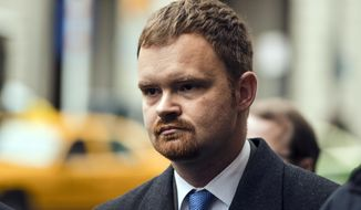 FILE - In this Dec. 20, 2017, file photo, Brandon Bostian, the engineer involved in the 2015 Amtrak derailment in Philadelphia that that left eight people dead and about 200 injured, departs from the center for criminal justice in Philadelphia. Manslaughter charges filed against Bostian have been dropped for a second time. A defense lawyer argued Tuesday, July 23, 2019, that any mistakes made by Bostian do not amount to a crime, and a city judge agreed. The state Attorney General's Office says it will appeal the latest ruling. (AP Photo/Matt Rourke, File)