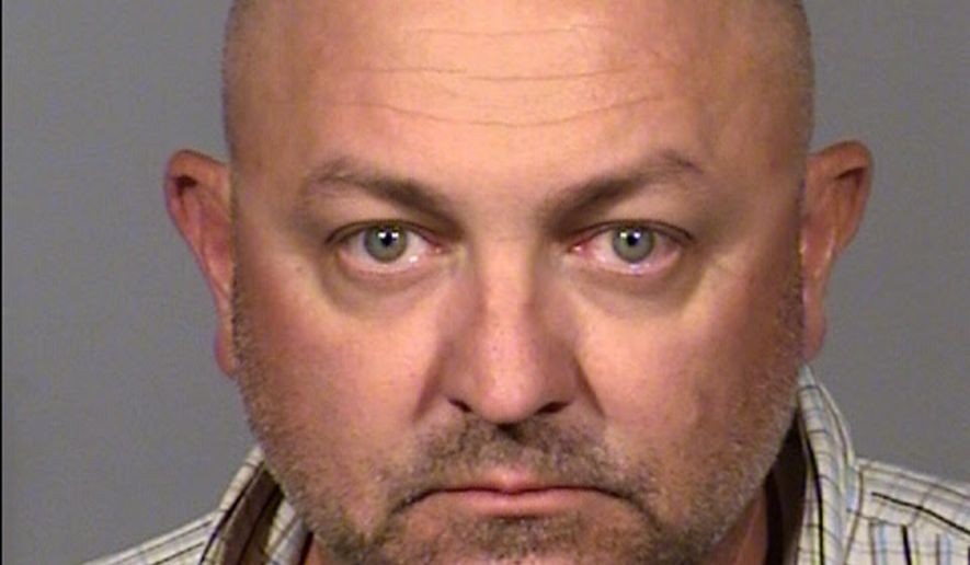 This undated Clark County jail booking photo shows Clinton Ryan, 44, of Las Vegas, following his arrest Sunday, July 21, 2019, on suspicion of driving under the influence, open container in a vehicle and failing to maintain a travel lane. Authorities say Ryan, the assistant police chief in North Las Vegas, was stopped while driving a pickup truck on a Las Vegas freeway towing a trailer with a horse inside. A city official says he's on paid leave pending an investigation. (Nevada Highway Patrol via AP)