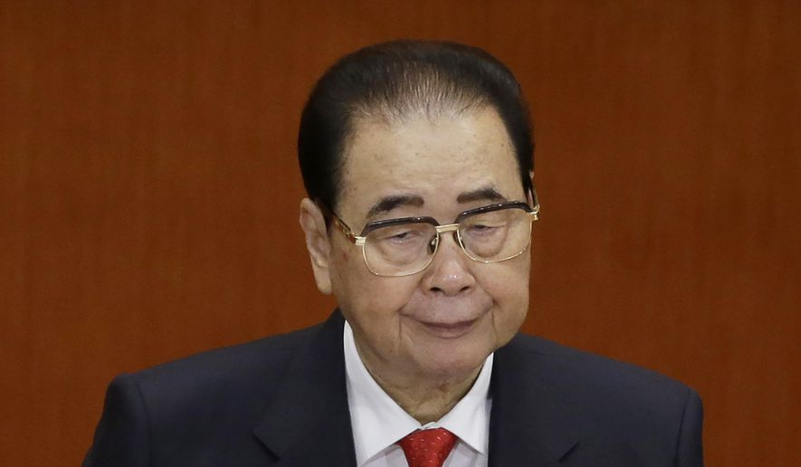 In this Nov. 8, 2012, file photo, former Chinese Premier Li Peng attends the opening session of the 18th Communist Party Congress at the Great Hall of the People in Beijing. Li Peng, a former hard-line Chinese premier best known for announcing martial law during the 1989 Tiananmen Square pro-democracy protests, has died. He was 91. (AP Photo/Ng Han Guan, File)