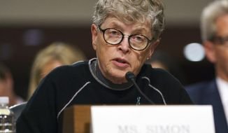 FILE - In this June 5, 2018 file photo, former Michigan State President Lou Anna Simon testifies before a Senate subcommittee in Washington. A judge may not rule for months on whether Simon, a former Michigan State University president stands trial for allegedly lying about her knowledge of allegations against Larry Nassar. A state prosecutor and an attorney for Lou Anna Simon gave closing statements in her preliminary exam Tuesday, July 23, 2019.  (AP Photo/Carolyn Kaster, File)