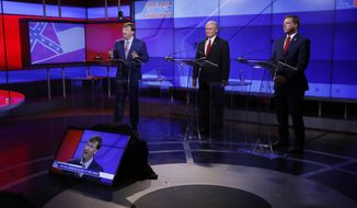 Former state Supreme Court Chief Justice Bill Waller Jr., center, and Rep. Robert Foster, R-Hernando, right, listen as Lt. Gov. Tate Reeves answers a question during a GOP gubernatorial primary debate in Jackson, Miss., Tuesday, July 23, 2019. (AP Photo/Rogelio V. Solis)